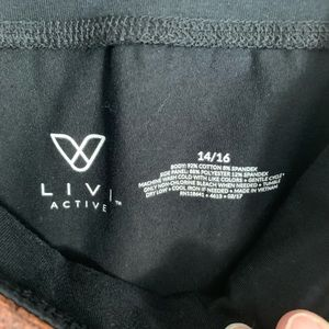 Livi Active Pants & Jumpsuits - Livi Active | Biker shorts with copper accent 14